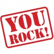 YOU ROCK! red Rubber Stamp vector over a white background. — Stock Vector #53490945