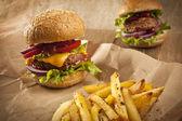 Fresh hamburgers with fries — Stock Photo