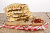 Toasted meat ( turkish kavurma ) and cheese sandwich — Stock Photo