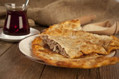 Turkish meat pie fried in oil ( Cig borek ) ( Raw pie or Tatar pie ) — Stock Photo