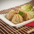 Wonton - Oriental deep fried wontons filled chinese dumpling — Stock Photo #54373321