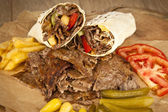 Doner Kebab - grilled meat, bread and vegetables shawarma sandwich — Stock Photo