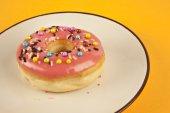 Colorful fresh doughnut on yellow background — Stock Photo