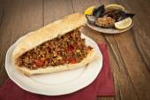 Turkish Kokorec - lamb intestine food sandwich with midye dolma — Stock Photo
