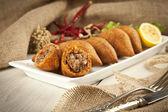 Turkish Ramadan Food stuffed icli kofte ( meatball ) falafel — Stock Photo