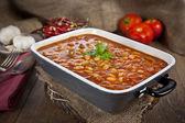 Hot turkish bean stew with a tasty tomato sauce. — Stock Photo
