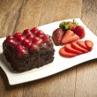 Piece of chocolate cake with icing and fresh berry — Stock Photo #55482341