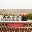 Makizushi. Delicious kani, tobiko and maki sushi rolls on white plate concept — Foto de Stock   #55745471