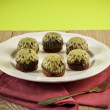 Homemade chocolate with crushed pistachios, shallow focus — Stock Photo #55750981