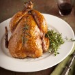 Grilled turkey and various vegetables on wooden plate for christmas and thanks giving day — Stock Photo #55752657