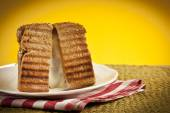 Toasted cheese sandwich with melting cheese oozing out. — Stock Photo