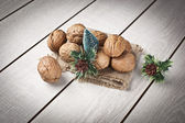 Walnuts with christmas xmas orient products — Stock Photo