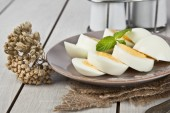 Boiled eggs with mint leaf and white wooden table — Stock Photo