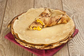 Pancake crepe with cheese on a hot stove — Stock Photo