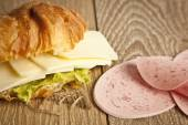 Close up of ham and cheese croissant sandwich. — Stock Photo