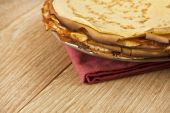 Pancake crepe on a wooden background — Stock Photo