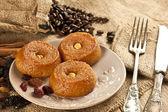 Turkish Ramadan sweet - Sekerpare with wooden background — Stock Photo