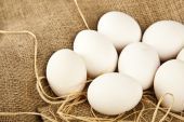 Eggs with fabric background — Stock Photo