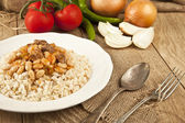 Hot turkish bean stew with a tasty tomato sauce and rice turkish pilav — Stock Photo