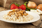 Hot turkish bean stew with a tasty tomato sauce and rice turkish pilav — Stock Photo