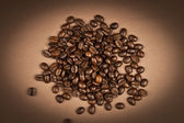 Coffee beans with brown background — Stock Photo