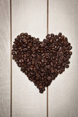 Love heart shape with coffee beans — Stock Photo