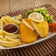 Fried Schnitzel Chicken and pork chop French fries and vegetables — Stock Photo #65835807