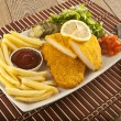 Fried Schnitzel Chicken and pork chop French fries and vegetables — Stock Photo #65836147