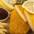 Fried Schnitzel Chicken and pork chop French fries and vegetables — Stock Photo #65859771
