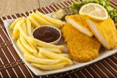 Fried Schnitzel Chicken and pork chop French fries and vegetables — Stock Photo