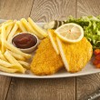 Fried Schnitzel Chicken and pork chop French fries and vegetables — Stock Photo #65860971
