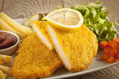 Fried Schnitzel Chicken and pork chop French fries and vegetables — Foto de Stock