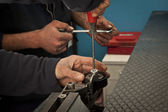 Auto mechanic working in garage. Repair service. — Stockfoto