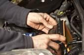 Auto mechanic working in garage. Repair service. — Stock Photo