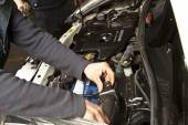 Auto mechanic working in garage. Repair service. — Stock Photo