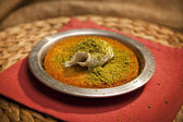 Turkish dessert kunefe with pistachio powder — Stock Photo