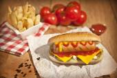 Hot Dog with fries and cheddar cheese concept background — Fotografia Stock