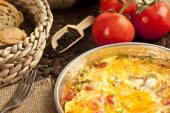 Menemen Turkish breakfast food egg, tomatoes and pepper in pan — Stock Photo