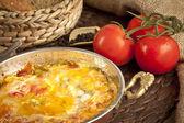 Menemen Turkish breakfast food egg, tomatoes and pepper in pan — Stock Photo