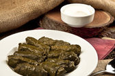 Dolma, stuffed grape leaves in a bowl, turkish and greek cuisine — Stock Photo