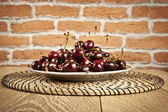 Cherries on wooden table with water drops macro background — Stock Photo