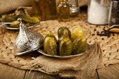 Pickled Cucumbers with wooden background — Stock Photo