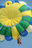 Parachute sky sport summer weather girl flight slings dome wind drive height delight air — Stock Photo