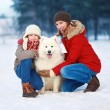 Beautiful happy family, mother and son walking with white Samoye — Stock Photo #52918807