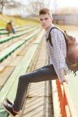 Outdoor lifestyle portrait of handsome guy with backpack summer  — Stock Photo