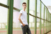 Fashionable handsome man model posing outdoors in summer day. St — Stockfoto