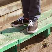 Modern hipster in gumshoes in summer urban style  — Stock Photo
