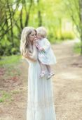 Tender photo mother and daughter in spring day — Stock Photo