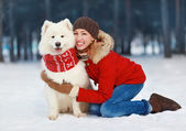 Joyful beautiful stylishly dressed young woman in red jacket hug — Stock Photo