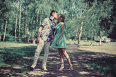 Couple in love kissing outdoors — Stock Photo
